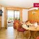 Fewo Kaiserwinkl, 1-2 Personen, Urlaubsfeeling - gemütlicher Wohnraum mit Flat-TV und sonniger Terrasse