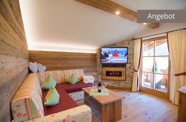 Ferienwohnung Kaiserwinkl Suite für 2 Personen mit Sitzecke, Kamin und TV