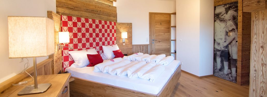 Ferienwohnung Reit im Winkl - Ferienwohnungen Neumaier - Fewo 5-Sterne Kaiserwinkl Suite Schlafzimmer